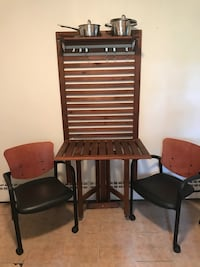 two black-and-brown armchairs 516 mi