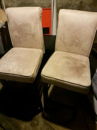 two padded bar chairs with brown wooden frame