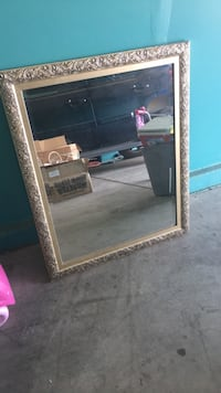 Rectangular brass-colored-framed floral embossed wall mirror Bakersfield, 93301
