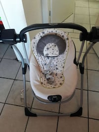 white and black swing chair