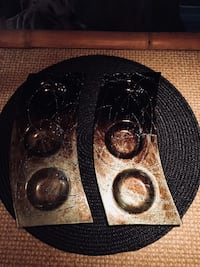 two brown metal tealight candle holders