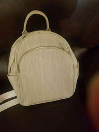 Beige ladies backpack nearly new Calgary, T3J 3M6