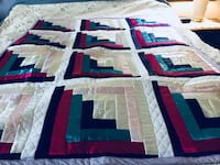 White, blue, and green quilt .