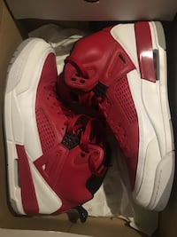 Pair of red-and-white nike basketball shoes Parkville, 21234