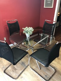 Black metal framed glass top table with chairs set. Owned for less than 10 months. Barely used between two people. Basically new condition. Macungie, 18062