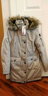 Brand new winter jacket, women's, tag says xs but fits bigger