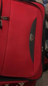 Red and black luggage bag by American Travel Clinton, 39056