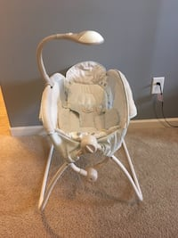 Baby Rock with musical mobile
