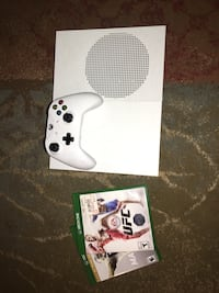 white Xbox One console with controller and game case East Hartford, 06108