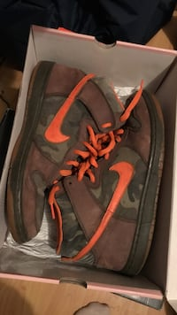 brown-black-and-green camouflaged Nike SB high-top sneakers with box