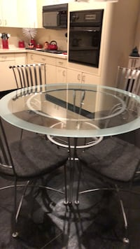 Round clear glass top table with silver base and 4 matching chairs Stony Brook, 11790