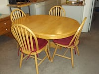 oval brown wooden table with four windsor chairs dining set OXNARD
