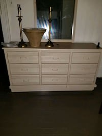 Beige Wood Dresser With Mirror.