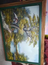 square green wooden framed tree near red house pai Welland, L3B 5N5
