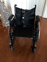 black and gray folding wheelchair 23 mi