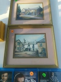 two brown wooden framed paintings. 11x14 Fort Walton Beach, 32548