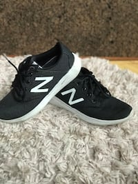 Pair of black-and-white new balance running shoes