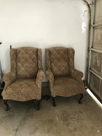 two brown floral fabric sofa chairs