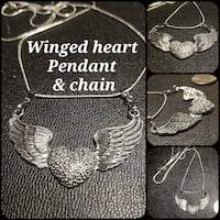 Brand new.  large Silver winged heart pendant Queen Creek, 85140