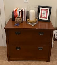 Solid wooden 2 drawer filing cabinet with smooth sliders for legal or letter size files.