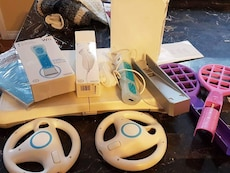 white Nintendo Wii with game assorted game controllers