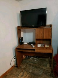 black flat screen TV with brown wooden TV stand Silver Spring, 20906