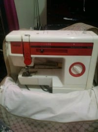 white and red Singer electric sewing machine Charlotte, 28213