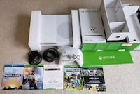 white Sony PS3 console with controller and game cases San Diego, 92101