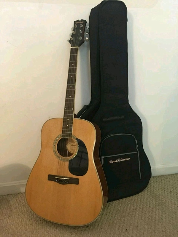 brown and black acoustic guitar with case