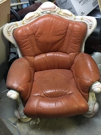 Brown leather armchair. very unique and comfortable.