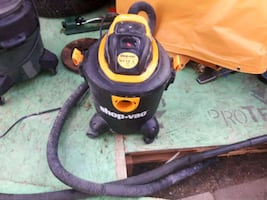 black and yellow Shop-Vac vacuum cleaner