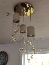 Crystal rose gold Chandelier 3 lights , its so beautiful , I bought $300  , it's have small crack . Richmond Hill, L4C 3H8