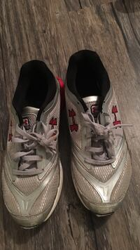 pair of grey-and-red Under Armour low top sneakers