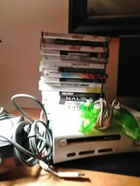 white Nintendo Wii console with controllers and game cases Phoenix, 85015