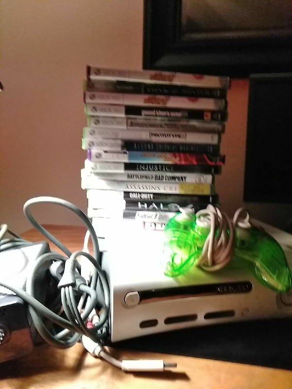 white Nintendo Wii console with controllers and game cases