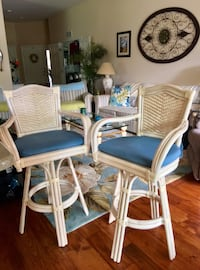Two swivel counter height chairs. Beautiful cream wicker, gently used in excellent condition. $140 is for the set. Cape Coral, 33991