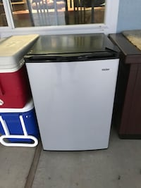 white and black single-door refrigerator