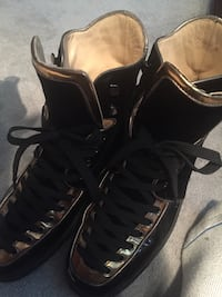 Pair of black leather high-top sneakers Toronto, M9A 4C7