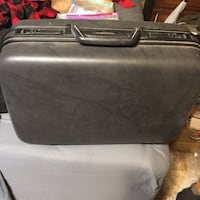 Suitcase with wheels. Brand (Lancaster) Miami Springs, 33166