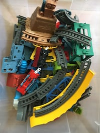 Two Thomas the Train sets w/ motorized cars.- no instructions.