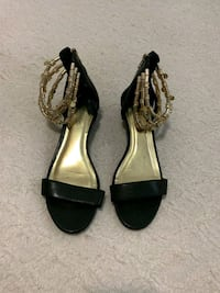pair of black leather open-toe heeled sandals Brooklyn, 11226