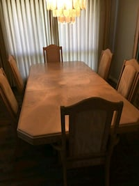 rectangular brown wooden table with six chairs dining set Kelowna, V1Y