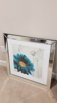silver-colored steel framed painting of flower