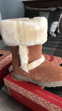 Pair of brown-and-white sheepskin boots brand new Germantown, 20876