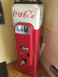 White and red coca-cola dispenser