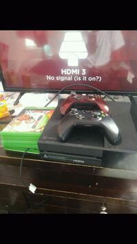black Xbox One console with controller and game cases Detroit, 48228