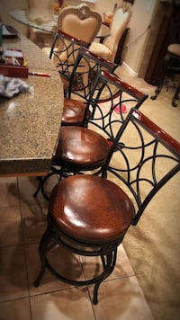 Four super heavy, sturdy swivel bar stools   Very heavy, sturdy, swivel, beautiful leather color  Each cost originally $170.99 Smoke and pet free        Modesto, 95356