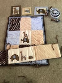 brown and blue crib pads