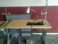brown wooden and gray steel sewing machine frame