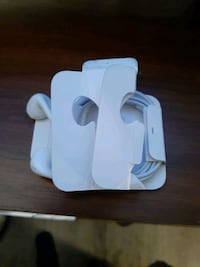 iPhone earbuds, charger, and adapter